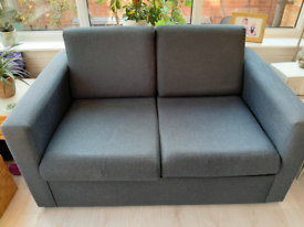Navy blue sofa bed with sprung mattress
