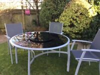 Large glass garden/conservatory table and chairs