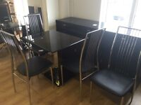 Small glass table and 4 chairs -- good condition -- delivery available !!!