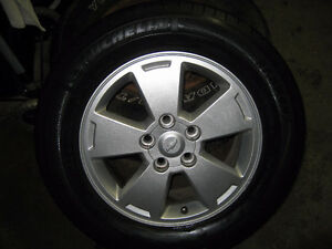 4 - MICHELIN P225/60R16 M+S TIRES ON GM ALLOY RIMS - $500