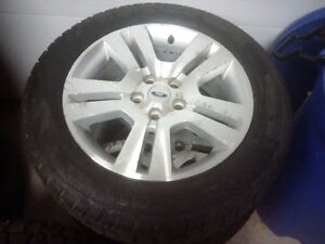 "4 - 17"" Ford rims and winter studded tires"