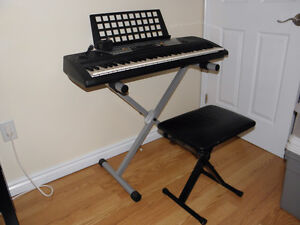 YAMAHA ELECTRIC KEYBOARD WITH STAND - CHAIR - POWER SUPPLY