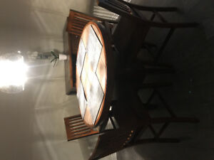 Bar height table, 4 chairs and hutch
