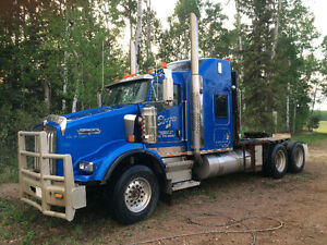 Class 1 winch and lowboy truck driver