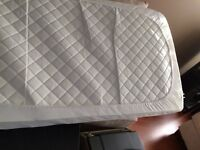 Crib or toddler bed mattress with mattress cover