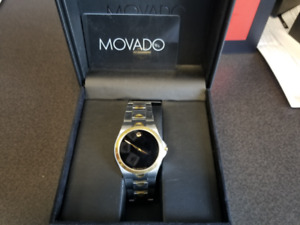 MOVADO GOLD AND SILVER SAPHIRE CRYSTAL BLACK FACE