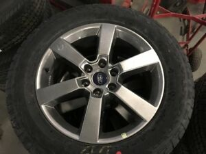 P275/55/R20 FACTORY TAKE OFF TIRES AND ALUMINUM RIMS
