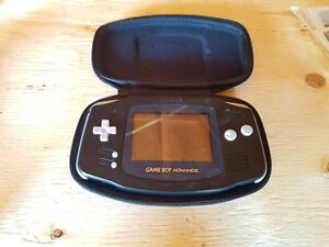Black Gameboy advanced with 4 games and accessories