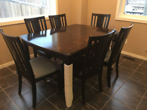 Solid wood dining table with leaf and 6 chairs