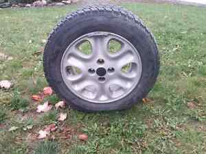 Four Toyo winter tires on rims Cornwall Ontario image 2