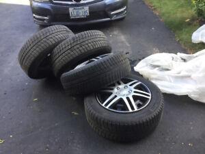 Snow tires on rims: Michelin X- ice 215-55-R16. 97H