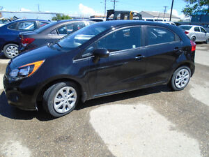 Low Kms.  $6,995.00  2012 Kia Rio EX 4 door Hatchback