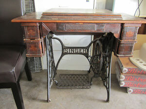 Antique singer sewing machine and cabinet table