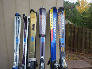 3 good pairs of skis for sale .