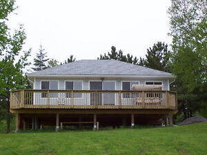 ***New Price***   2 year-round cottages on waterfront property