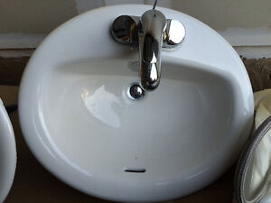 New oval bathroom sinks + faucets for sale