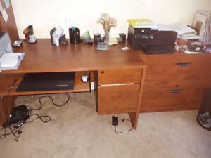 Desk with attached filing cabinet