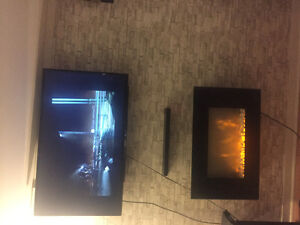 Black electric fireplace and black flat screen tv