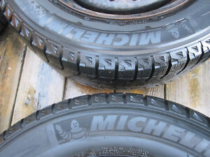 205/65R15 Michelins. 4 winter and 4 summer on steel rims w caps. Kitchener / Waterloo Kitchener Area image 3