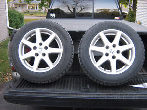 205 60R 16 SNOW TIRE ON FACTORY RIMS