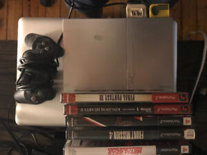Selling PS2 slim silver with games $60