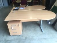 Beech managers reception desk with underdesk pedestal drawers.
