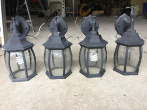 Four black outdoor coachlights