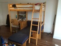 Loft bed with single on top and seating underneath