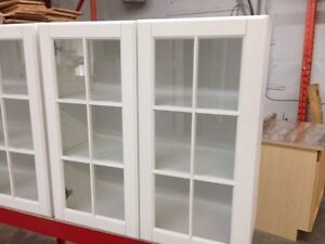 Wall cabinet with mullion glass doors.