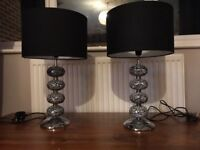 Pair of chrome bedside lamps with crackle glass base