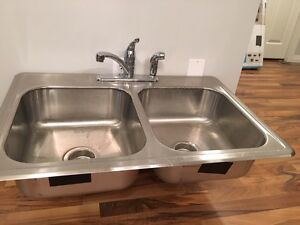 Stainless steel kitchen sink and faucet