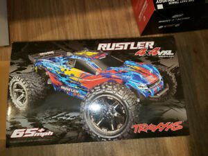 RC Rustler 4x4 VXL with 3s LIPO(x3) charger and extra parts