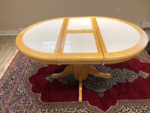 A wooden and ceramic dining table