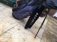 Nike golf bag and left handed golf clubs with golf balls and tees