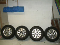 Four 5-bolt 215-65-R15 Michelin Tires and Rims