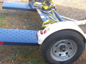 Car haul trailer with tie down straps
