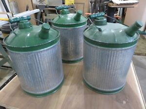 VINTAGE STEEL GAS CANS ASKING $25 EACH OR BEST OFFER PHONE 627-4