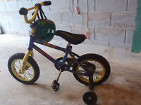 kids bike with learning wheels and helmet