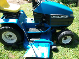 "Used New Holland 18HP Kohler Command, 52"" Cut."