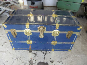 large blue metal steamer trunk in great cond
