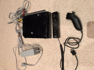 Nintendo Wii with all cables, nunchuck and two controllers