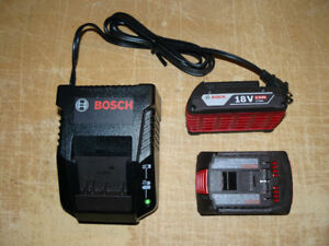 NEW Bosch 18V battery charger and 2 batteries ( 2 Ah. )
