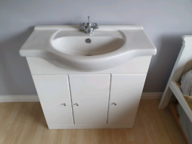 En suite wash hand basin with cupboard