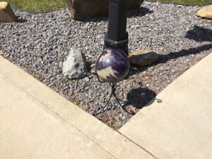 10 pin Bowling ball & stand . ( was used as lawn ornament)