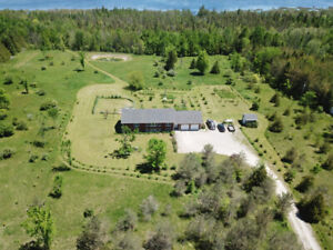 34 Acres -Custom built home with waterfront!