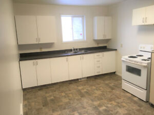 2 bedroom unit with large fenced backyard, available now