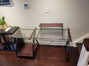 Glass and wood office desk with built in monitor stand
