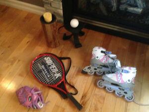 Girl's roller blades, tennis raquet and girl's baseball glove