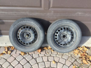 2 Used Tires w/GM Rims 215 / 60 / R 16.