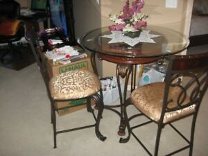 Ashley's furniture glass dining table and two chairs